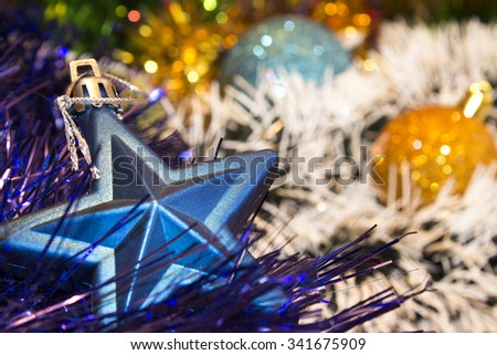 Background for New Year's and Christmas cards. Celebratory  holiday bright rainbow decorations for Christmas trees or pine. Focus on star - stock photo