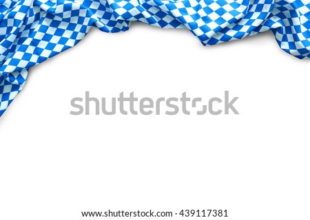 Background for Oktoberfest with bavarian white and blue fabric isolated on white - stock photo