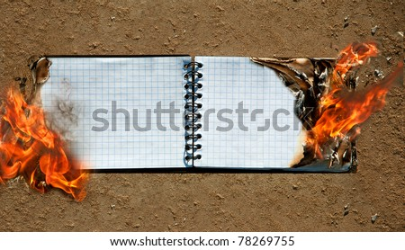 Background from a burning notebook, paper - stock photo