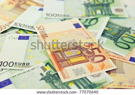 Background from a lot of euro banknotes, shallow depth of field - stock photo