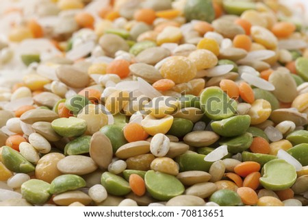 Background from a mix of different groats and beans. A shot horizontal, focus in the foreground. - stock photo
