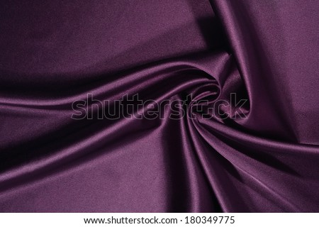 Background from a plum satin fabric with picturesque folds - stock photo
