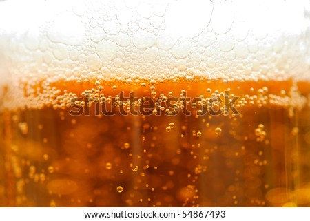 Background from a surface of beer with a sun beam - stock photo
