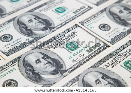 Background from a variety of hundred-dollar bills. Many money. Dollars background. Real money. - stock photo