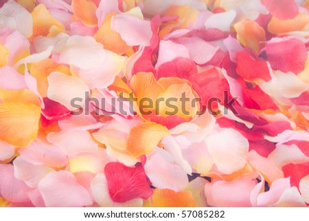 Background from  artificial petals of roses - stock photo