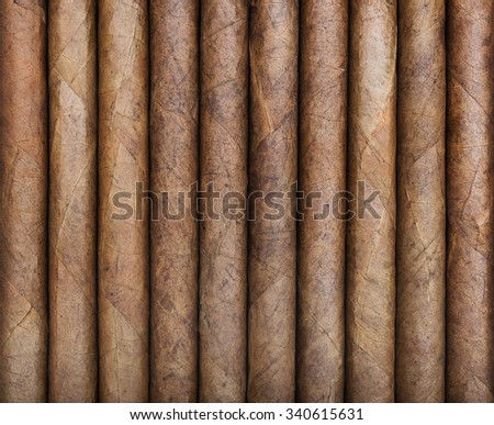 Background from big cigars in a row - stock photo