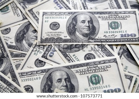 background from chaotically lie one hundred greenbacks - stock photo