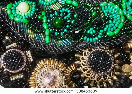 Background from close up of various jewelry made of stone and metal