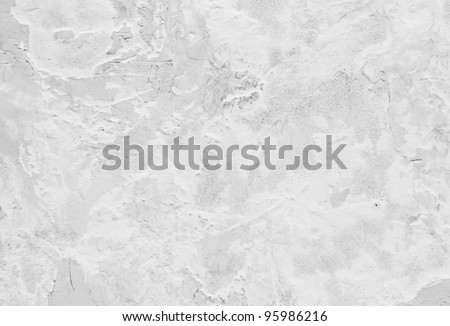 Background from closeup high detailed fragment textured of white stone wall a old building - stock photo