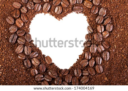 background from coffee beans in the frame of heart, isolated on white - stock photo