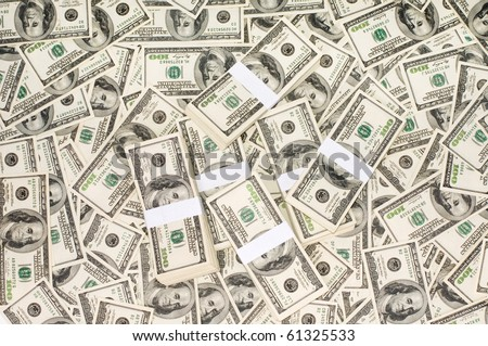 Background from dollar denominations and stack of money
