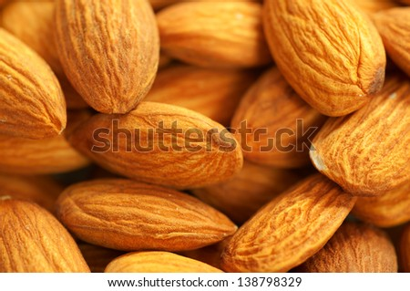 Background from fresh dry peeled almond nuts