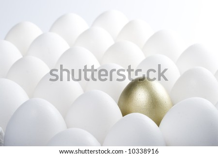 Background from fresh eggs and one gold egg. Concept for sucess.