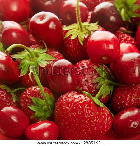 Background from fresh ripe strawberries and cherry
