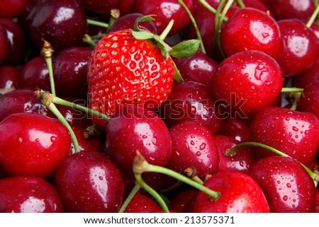 Background from fresh ripe strawberries and cherry - stock photo