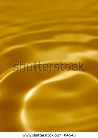 Background from golden liquid - stock photo