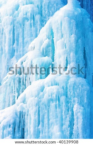 Background from ice and icicles of blue color - stock photo