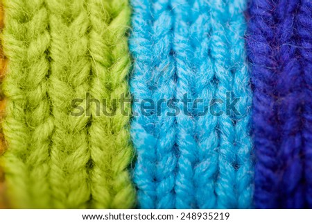 Background from knitted rainbow. texture of wool products. Comfortable home background. - stock photo