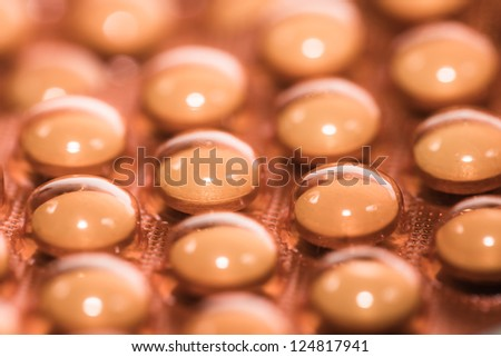 Background from macro of yellow medicine pills