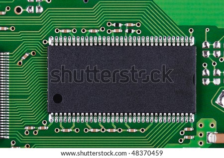 Background from microchip and pcb macro - stock photo