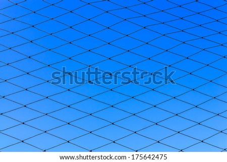 Background from net and blue sky - stock photo