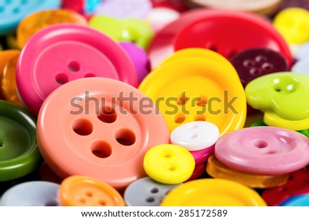 Background from of colorful buttons of different shapes, close-up. - stock photo