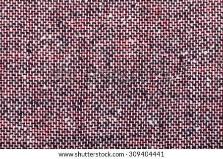background from red black and white woolen neps fabric close up - stock photo