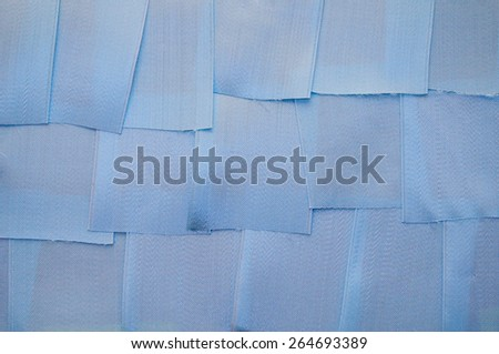 background from small pieces of satin ribbons blue - stock photo