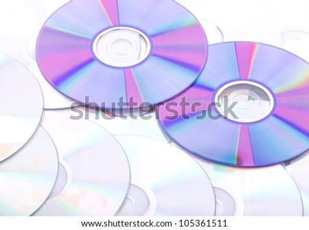 Background from the compact discs of CD and DVD - stock photo
