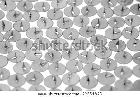 Background from thumbtacks on white - stock photo