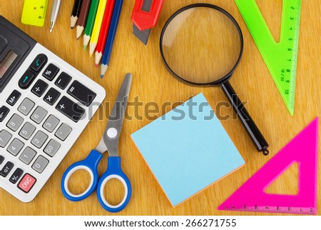 Background from Various office supplies on wooden table - stock photo