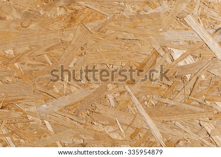 Background full frame macro texture of chipboard made from compressed wood chips in resin used in the building and construction industry
