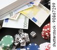 background gambling with euro banknotes, casino chips, cards and dices - stock photo