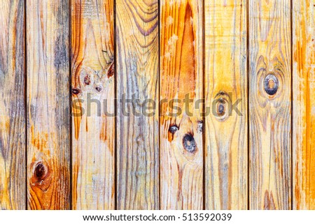 Background gloomy charred wooden fence in dark colors