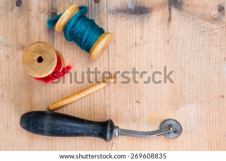 background - grunge vintage sewing accessories  - stock photo