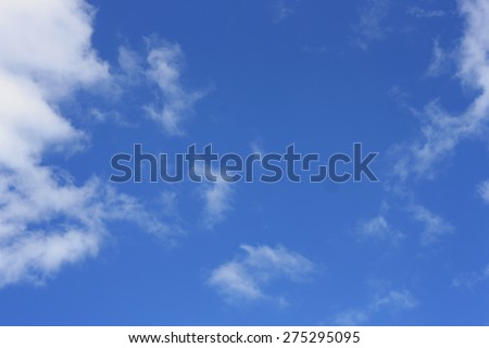 Background image of a bright blue sky with big Cumulus clouds - stock photo