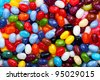 Background image of brightly coloured jelly beans - stock photo