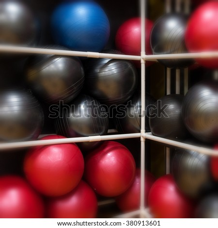 Background image of exercise balls in fitness center