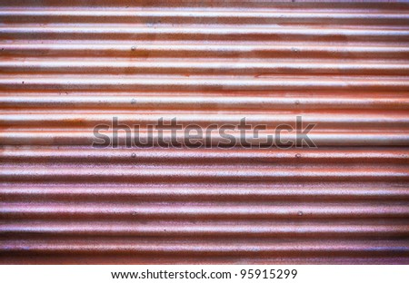 Background image of multi toned rustic corrugated metal - stock photo