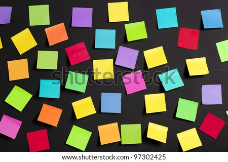 background image of multicolor notes on a black board - stock photo