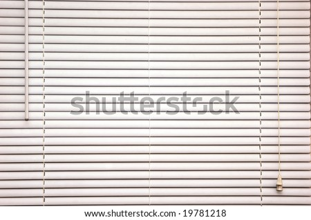 background image of off white mini blinds inside home closed - stock photo