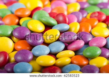 Background image of sweet candies or chocolate buttons