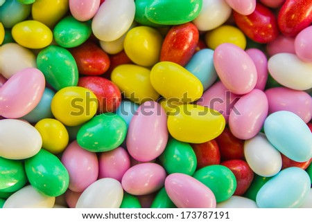 Background image of sweet jordan almonds or chocolate buttons
