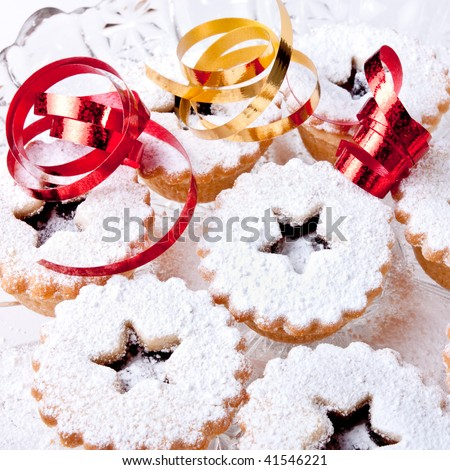 Background image of Sweet Mince Pies and ribbons dusted with icing sugar. - stock photo