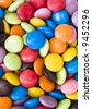 Background image of sweet smarties or chocolate buttons - stock photo