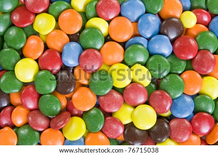 Background image of sweet smarties or chocolate buttons. - stock photo