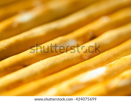 Background image texture of crackers as straw close-up. - stock photo