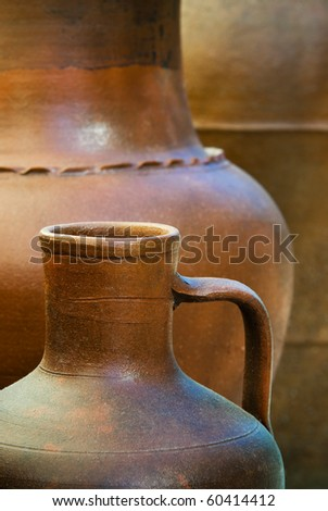 Background image with details of three clay pots in a row - stock photo