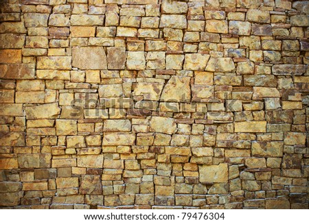 Background in the form of a wall from a granite stone - stock photo