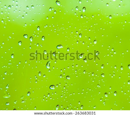 background in the form of water drops on a green background - stock photo